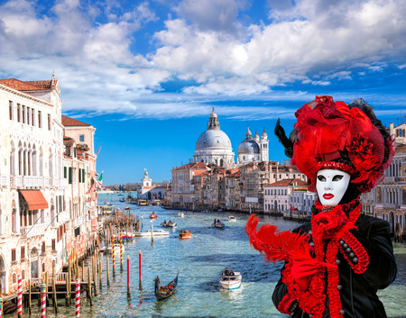 Famous Carnival mask against Grand Canal in Venice, Italy Imagens