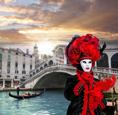 Carnival mask against Rialto bridge in Venice, Italy