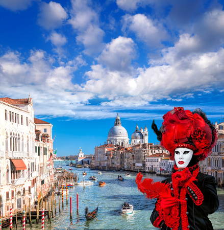 Famous Carnival mask against Grand Canal in Venice, Italy Stock Photo