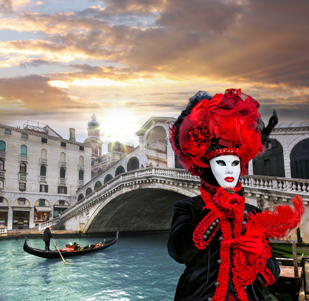 Carnival mask against Rialto bridge in Venice, Italy