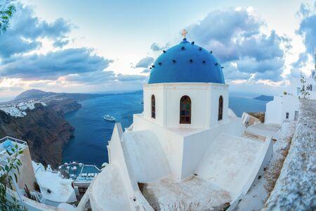 Santorini island with church against sunrise in Greece Stock Photo