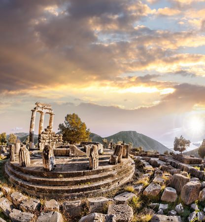 delphi: Delphi with ruins of the Temple against sunset in Greece