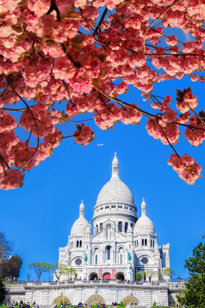 Famous Sacre Coeur Cathedral during spring time in Paris, France
