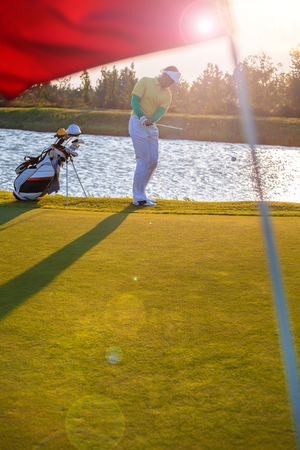 game drive: Man playing golf against colorful sunset