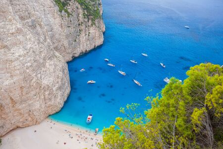 Navagio beach with yachts on Zakynthos island in Greece