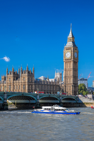 popular: Big Ben and Houses of Parliament with boat in London, England, UK