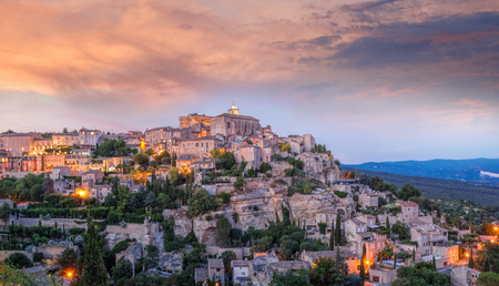 colorfull: Famous old village Gordes in Provence against sunset in France
