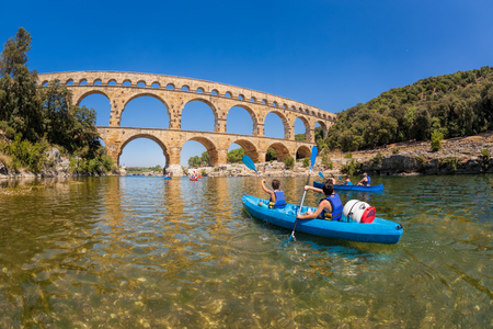 Pont du Gard with paddle boats is an old Roman aqueduct in Provence, France