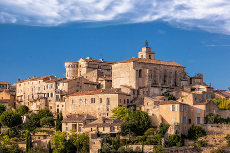 Famous old village Gordes in Provence against sunset in France