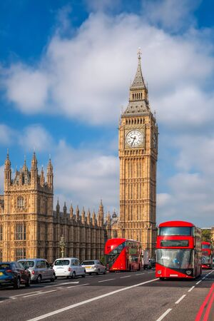 London with red buses against Big Ben in England, UK 版權商用圖片