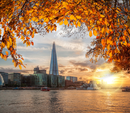 shard: Sunset over Thames with modern skyscrapers in London, England