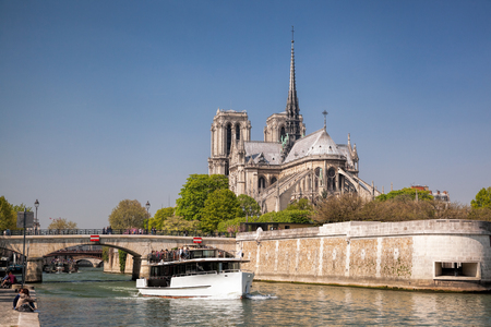 Paris, Notre Dame cathedral with boat on Seine, France Stock Photo