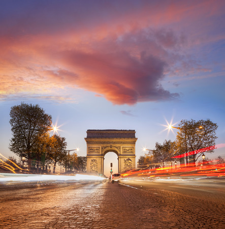 Arc de Triumph at night in Paris, France Фото со стока