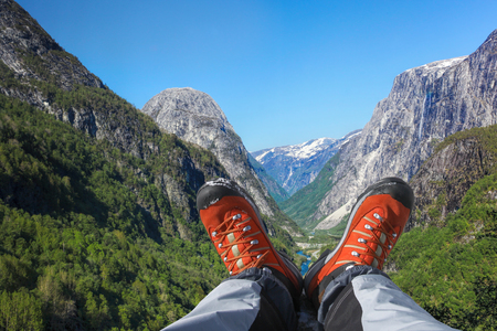 Deep valley with hiking boots close the Flam in Norway