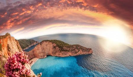 Navagio beach with shipwreck and flowers on Zakynthos island, Greece Stock Photo