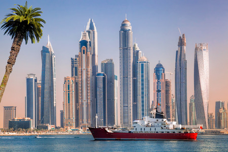 Panorama of Dubai with ship against skyscrapers in UAE Stock Photo
