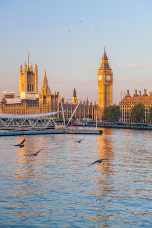 Big Ben and Houses of Parliament with boat in London, England, UK