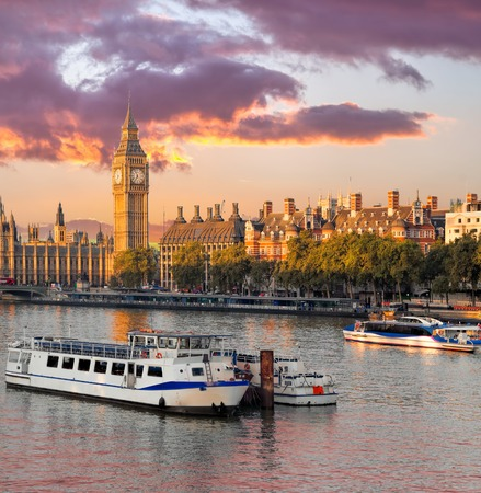Big Ben and Houses of Parliament with boat in London, England, UK Reklamní fotografie - 119604776