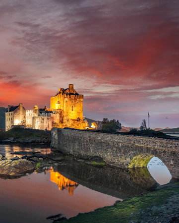 The Eilean Donan Castle with colorful sunset, Highlands of Scotland Reklamní fotografie - 120171296