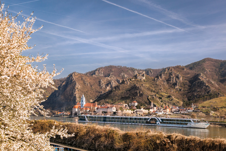 Durnstein village during spring time with tourist ship on Danube river in Wachau, Austria Reklamní fotografie
