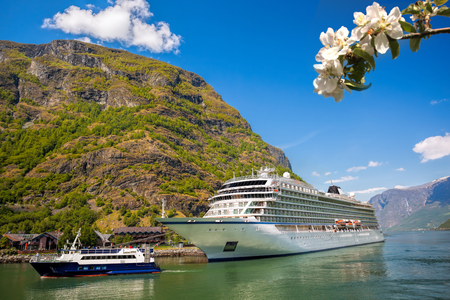 Flam village with ship in harbor against fjord during spring time, Norway Imagens