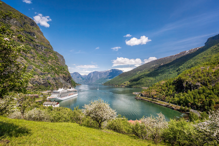 Flam village with ship in harbor against fjord during spring time, Norway Reklamní fotografie - 120713055