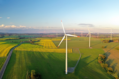 Wind turbines at sunset taken from the drone
