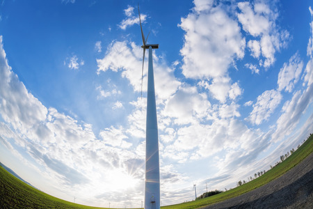 Wind turbines against blue sky during sunrise Reklamní fotografie - 123974149
