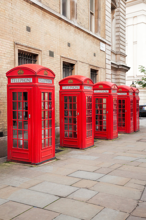 Famous red telephone booths in Covent Garden street, London, England Reklamní fotografie - 124364610