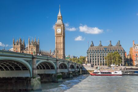 Big Ben and Houses of Parliament with boat in London, England, UK Reklamní fotografie - 125659021