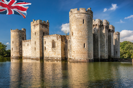 Historic Bodiam Castle with flag of England in East Sussex, United Kingdom