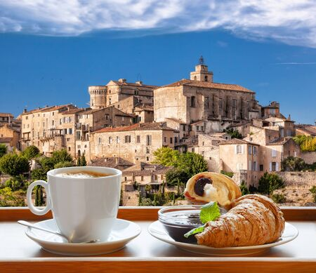 Coffee with croissants against Gordes village in Provence, France 스톡 콘텐츠