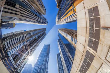 Skyscrapers against sunshine by fisheye in Dubai, United Arab Emirates
