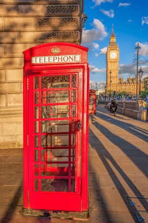 London with red phone booth against Big Ben in England, UK Stockfoto