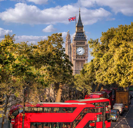 Big Ben with red buses in London, England, UK Editorial