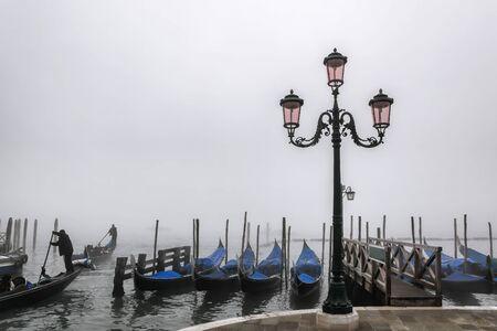 Venice with gondolas against foggy day in Italy Zdjęcie Seryjne
