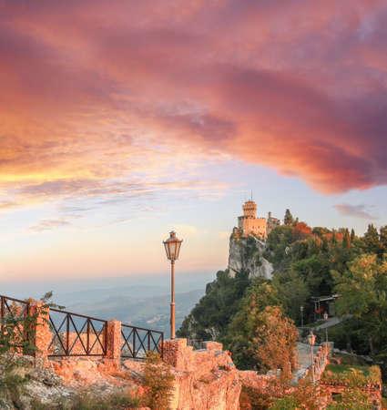 Castle Rocca della Guaita against sunset in San Marino republic, Italy
