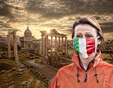 Woman wearing protection face mask with Italian flag against coronavirus in front of Roman ruins, Rome, Italy Zdjęcie Seryjne