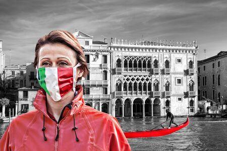 Woman wearing protection face mask with Italian flag against coronavirus near the Rialto bridge in Venice, Italy
