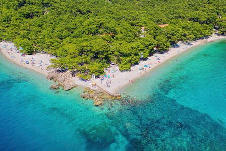 Famous Punta Rata beach with azure sea in Brela, Dalmatia, Croatia