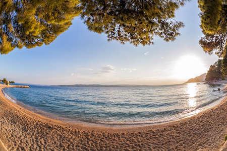 Amazing Croatian beaches against sunset in Brela, Dalmatia, Croatia