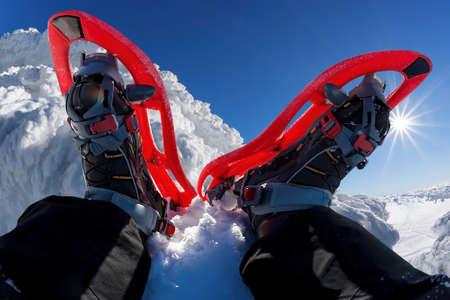 Snowshoes against winter rocky mountains Фото со стока