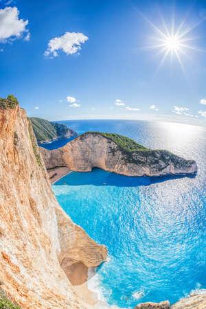 Navagio beach with shipwreck and flowers on Zakynthos island, Greece Фото со стока