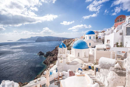 Oia village with churches against azure sea on Santorini island in Greece