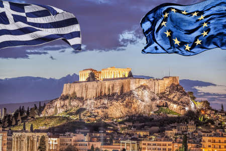 Acropolis with Parthenon temple against Greek and EU flags in Athens, Greece Фото со стока
