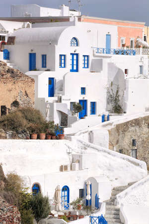 Oia village with typical houses on Santorini island in Greece