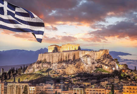 Acropolis with Parthenon temple against Greek flag in Athens, Greece