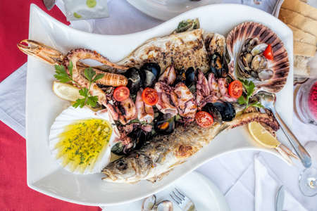 Amazing seafood plate with fish, scallops, prawns, octopus