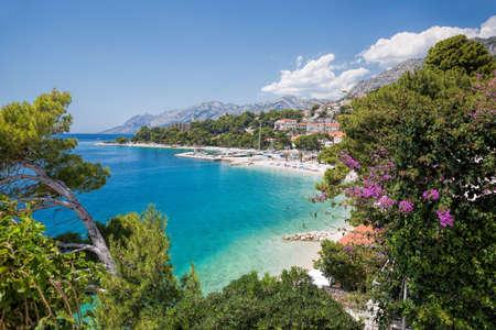 Amazing Croatian clean beaches with blue sky in Brela, Dalmatia, Croatia Фото со стока