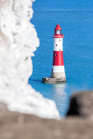 Beachy Head Lighthouse with chalk cliffs near the Eastbourne, East Sussex, England Фото со стока